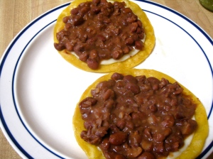 Crispy tortillas with cheese and beans