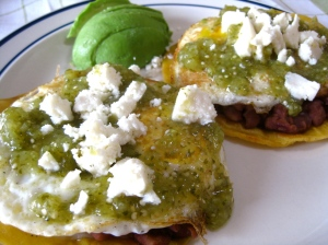 Huevos Rancheros with beans, tomatillo salsa, avocado, and queso fresco