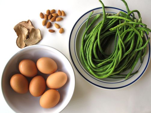 Eggs, galangal, and almonds for Indonesian Egg Curry; Chinese long beans