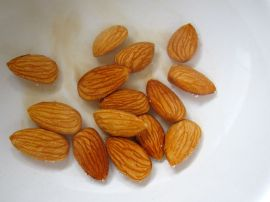 Blanching almonds for Sambal Goreng Telur (Indonesian Egg Curry)