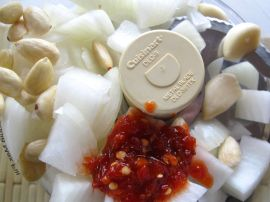 Blanched almonds, onion, and sambal oelek for Sambal Goreng Telur (Indonesian Egg Curry)