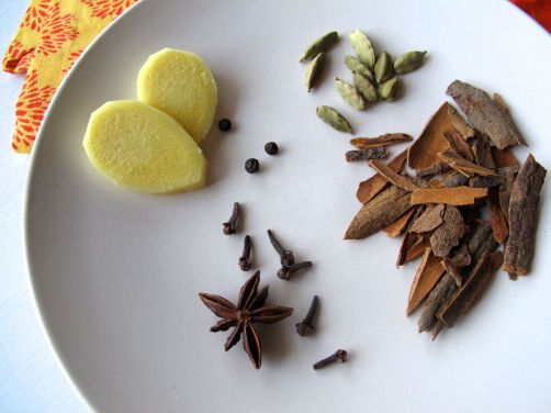 Ginger, cloves, peppercorns, cardamom, cinnamon, and star anise for homemade chai