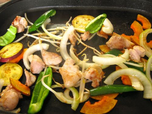 Onions, Japanese sweet potato, Japanese kabocha pumpkin, bean sprouts, green bell pepper, and chicken for yaki-niku