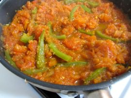 Onions, green bell peppers, and tomatoes for Parsi Tomato-Poached Eggs