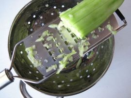 Grating the cucumber for Tzatziki