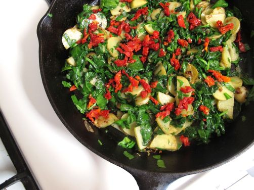 Frittata ingredients: Potatoes, spinach, and sundried tomatoes