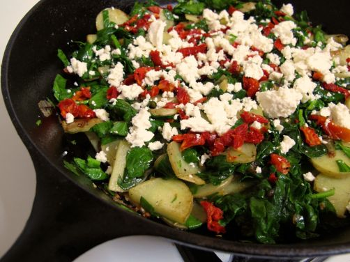 Frittata ingredients: Potatoes, spinach, sundried tomatoes, and feta