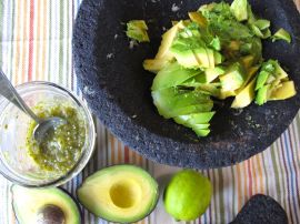 Making Roasted Tomatillo Guacamole with a molcajete