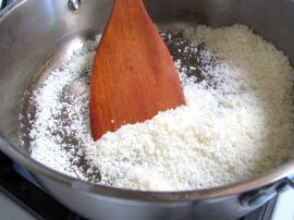 Toasting coconut for Raspberry Chocolate Tart with Coconut Crust
