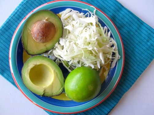 Avocado, lime, and cabbage for Avocado Chicken Tacos