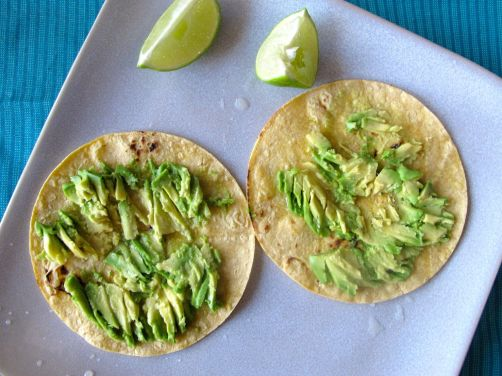 Avocado and lime on charred tortillas