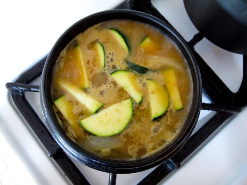 Making Doenjang Jjigae (Savory Korean stew with zucchini, tofu, and shrimp)