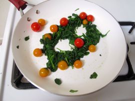 Making Spinach Nests for Skillet-Baked Eggs with Garlicky Yogurt and Cherry Tomatoes