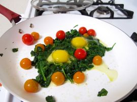 Spinach Nests for Skillet-Baked Eggs with Garlicky Yogurt and Cherry Tomatoes