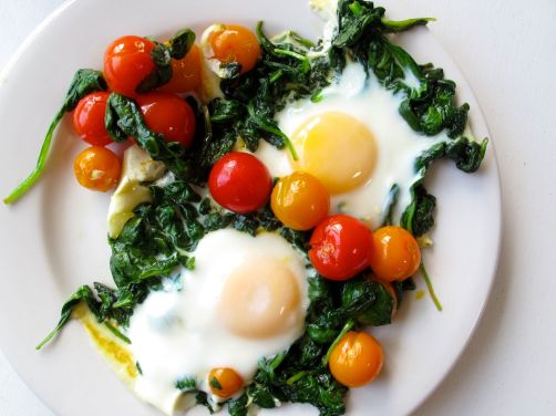 Skillet-Baked Eggs with Garlicky Yogurt, Spinach, and Cherry Tomatoes