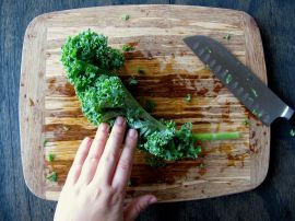 How to de-stem and chop kale: fold the leaves in half