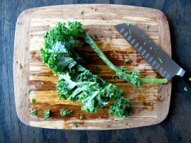 How to de-stem and chop kale: fold the leaves in half and cut away the stem