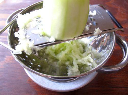 Grating cucumber for Tzatziki Yogurt Sauce