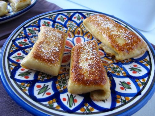 Pumpkin Cheese Blintzes caramelized in butter and sugar
