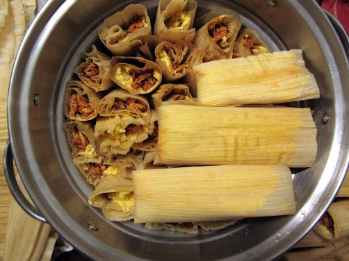 Packing the tamales into the steamer basket