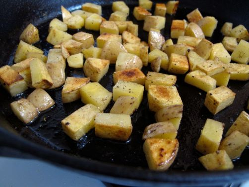 Making crispy skillet potatoes for Cheesy Skillet Potatoes and Eggs