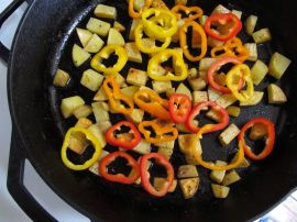 Making crispy potatoes and bell peppers for Cheesy Skillet Potatoes and Eggs