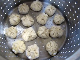 Nepali Momos (Steamed Dumplings) in a steamer basket