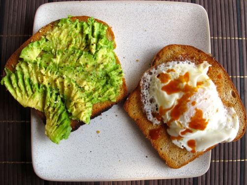 Avocado toast with a fried egg on 50/50 Sandwich Bread
