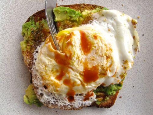 Avocado toast with a fried egg on 50/50 Sandwich Bread