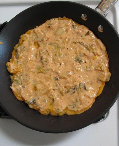 Frying Kimchijeon (kimchi pancake)