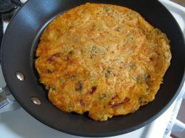 Frying the kimchijeon (kimchi pancake)