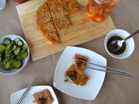 Serving the kimchijeon (kimchi pancake)