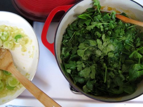 Making Garlicky Green Soup with spinach, kale, cilantro, and scallions